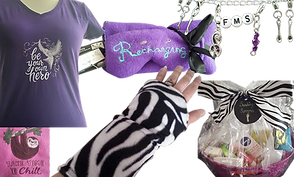 """A purple tee shirt with embroidery reading """"Be Your Own Hero"""" with an Owl flying on it.  A purple 2 pack of heating pads, one eye mask and one rectangular. The eye mask is embroidered with the word """"Recharging.""""  A silver bracelet with spoon charms and the letters """"FMS"""". A pink square of fleece with a sloth embroidered on that reads """"Take time to Chill.""""  A white person's hand wrapped in a zebra pattern heat wrap, and a large basket wrapped in celephane with a zebra patterned ribbon filled with various products."""