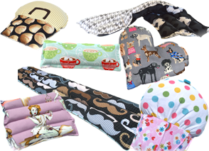 Heating pads in heart, cupake square and long rectangular shapes in a variety of fabrics