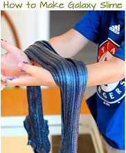 a child's hands and arms are holding a long stretchy length of slime that is several shades of blue and purple with glitter.