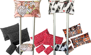3 sets of patterned crutch pads: a black and gray pattern, red with white dots, and a SF Giants pattern, as well as 2 crutches with pads- one with hot air balloons in pinkish tones, and another star wars themed.