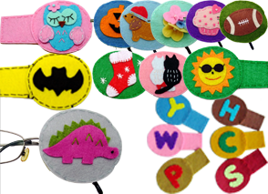 a range of felt eye patches with different characters, initials, and items on thm