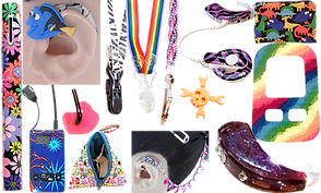 a pen covered with a multi-colored floral pattern, a model ear with a hearing aid that is decorated with a Dory charm, 2 different clips- one with a zebra ribbon, and one with a rinabow ribbon, a clip with a hair barrette attached, a skull and crossbones charm for a CI, a hearing aid decorated with a purple zebra pattern, a small bag with dinosaurs on it, a skin for a processing unit, a hearing aid receiver with a galaxy skin, a model head wearing a hearing aid that is attached with a beaded chain, a small triangular bag with zipper revealing hearing aid eqipment, a receiver decorated with a fireworks skin on it, and the in-ear portion of a hearing aid with black tubing.