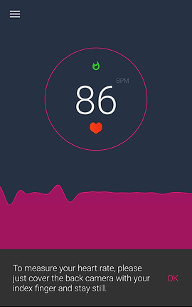 """Screenshot of Heart Rate Monitor App, a dark blue screen with small menu icon in the top left corner, and the pink outline of a circle in the center.  Inside the circle is a small green shape, a large white 86 with small gray BPM next to it, and a small red heart below it.  Below the circle is a dark pink visualization of a heart beat reading.  At the bottom of the screen is white text reading, """"To measure your heart rate, please just cover the back camera with your index finger and stay still."""