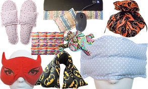 A variety of heating and cooling pads: a pair of heatable slippers, a set of wrist pads for working on the computer, an eyemask shaped like devil ears, a segmented heating pad, a neck wrap with batman pattern, a flat over-eye mask, a heatable frog shaped pad, and a heatable bundle pad with flame pattern.