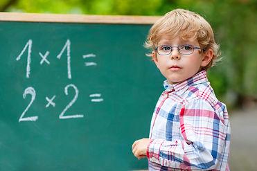 Preschool Kid Boy With Glasses At Blackb