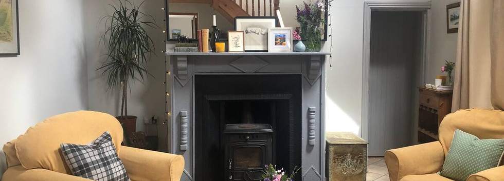 Double height living area with wood burning stove