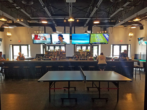 Coastal Taproom Bar ping pong table.jpg