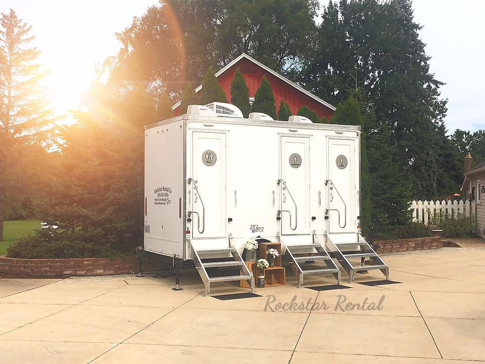 3 station portable bathroom trailer with running water, flushing toilets, heat, and air. Bathrooms that your guest will appreciate you later for!