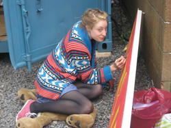 Harrie Hayes touching up the set