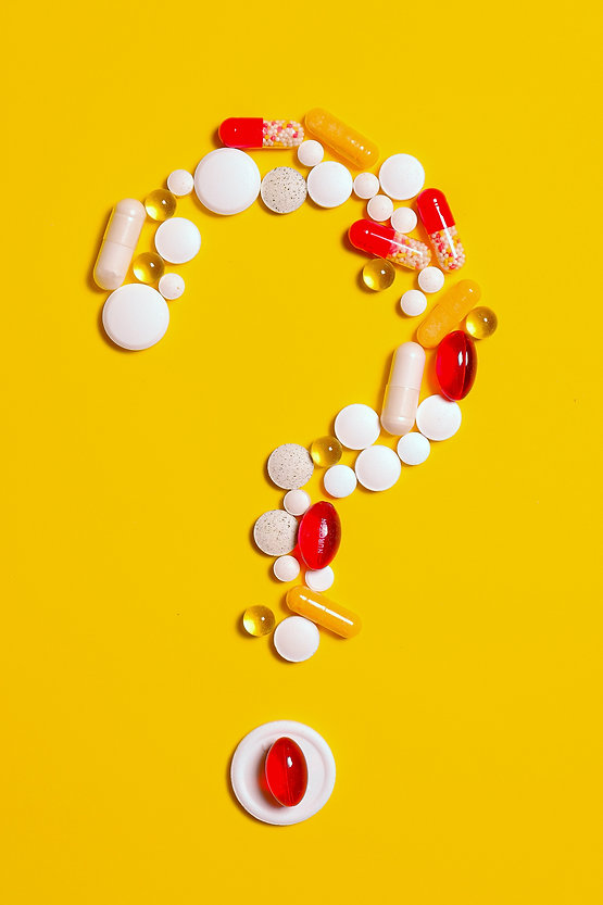 medication-pills-isolated-on-yellow-back