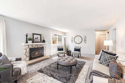 SASH home sale in Des Moines, WA, white living room fully staged for home sale process
