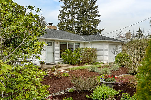 SASH Realty home listing, exterior photo with PNW front yard foilage