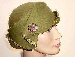 Hand scuplted wool green with button