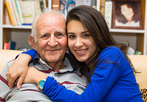 Father and daughter hugging, representing the senior services provided by SASH Realty