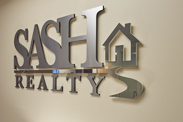 SASH Realty sign in their office