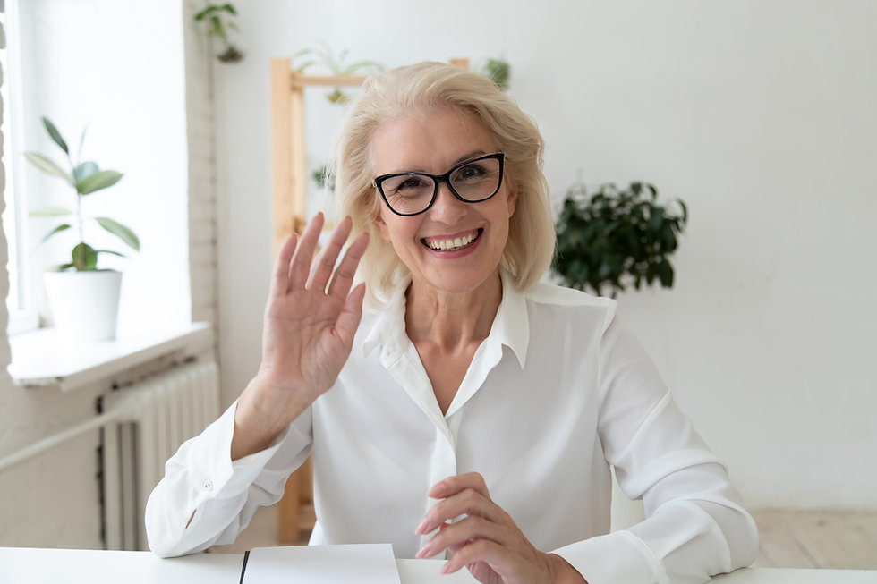 60 and older buiness woman coaching client with glasses