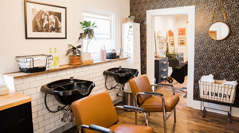 Photo of the inside of stylish La Vie Salon with hair washing stations