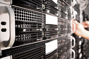 Faded image of servers for HDD Destruction Certified destruction Services