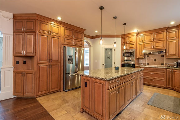 Kitchen with new appliances from a SASH Realty home sale