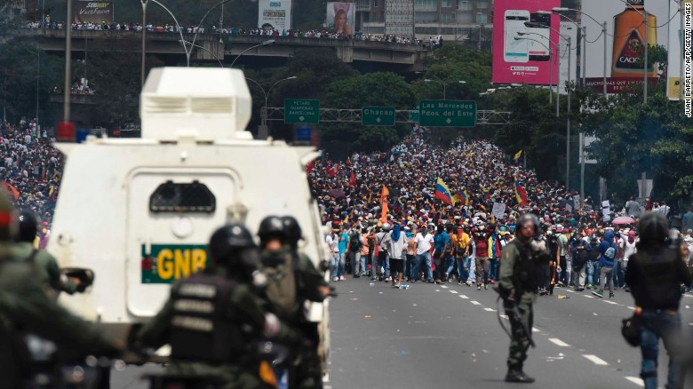 Protesters confront members of the National Guard in Caracas following the Supreme Court's dissolution of the National Assembly, 2017