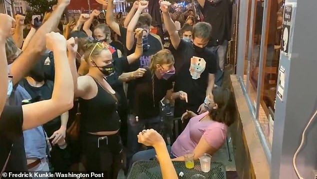 BLM protesters confront Lauren Victor at a Washington DC cafe