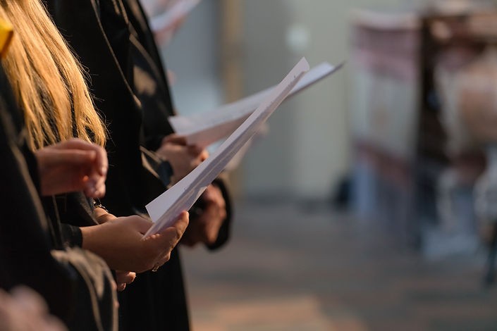 Choir singers holding musical score and