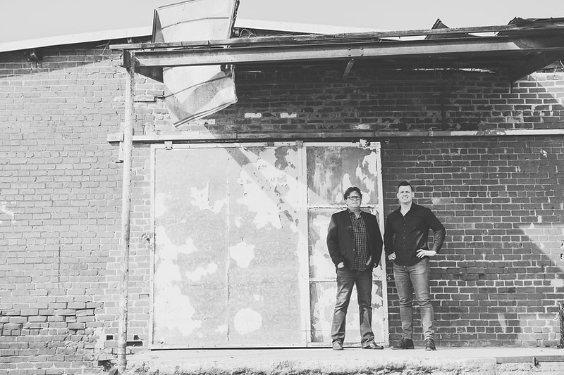 Father and son posing for photo. Owners of commercial construction company - general contractors in dalton, georgia.