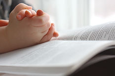 the hands of a young Christian child are