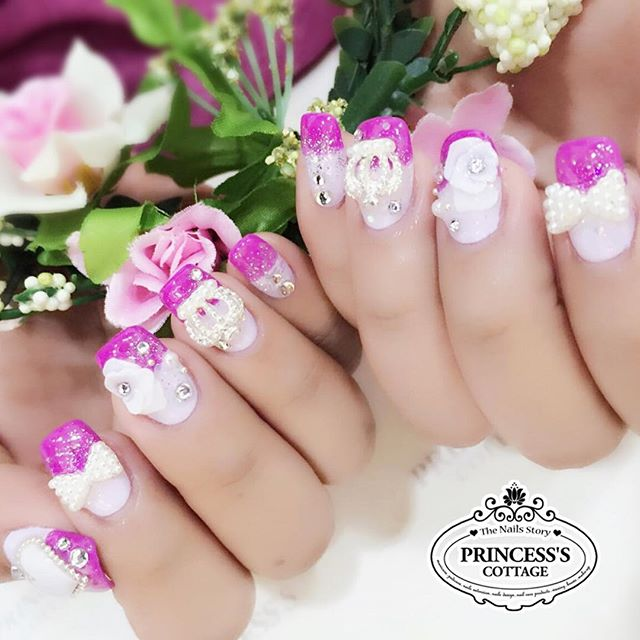 Bridal nails with a purple princess theme. We have bridal nails packages at a discount price, visit