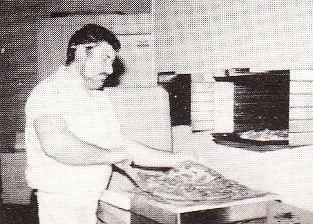 Hector cutting a pizza