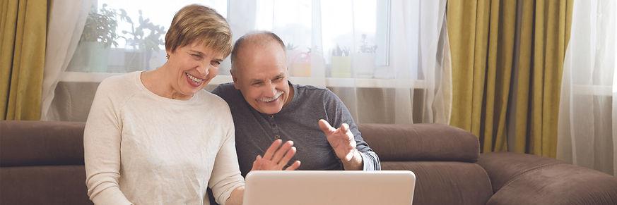 4.5x1.5 web - couple waving laptop.jpg