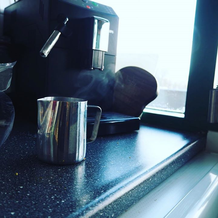 Cappuccino by his hand
