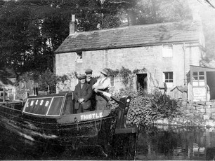 """""""Thistle"""" barge passing the cottage"""