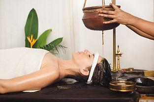 Girl getting Shirodhara Done - An Ayurvedic and alternative treatment