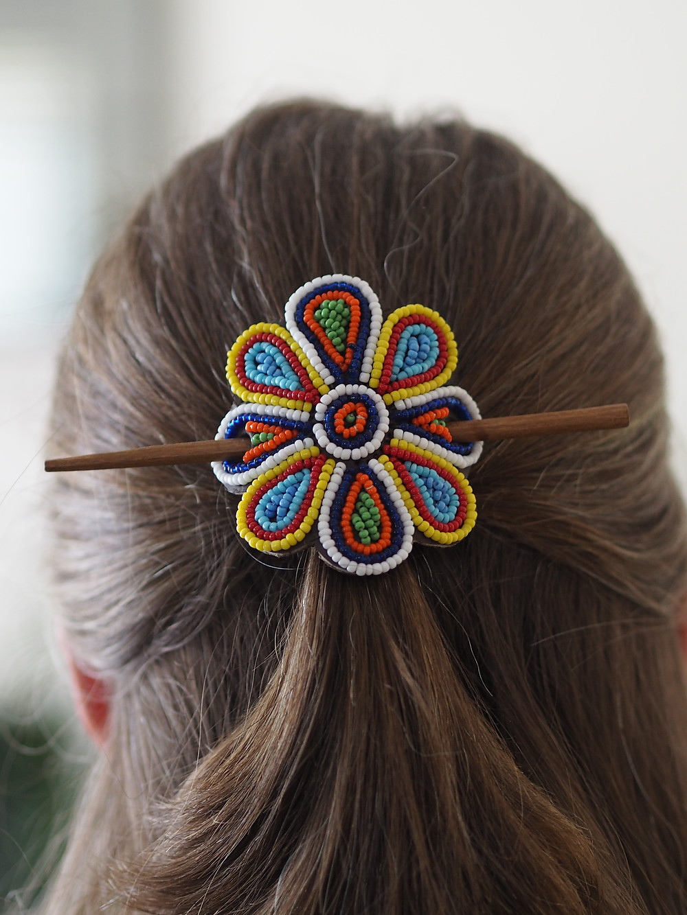 Masai handmade flower hairstick barrette in hair. Available to buy at Wild Home Online on Etsy.