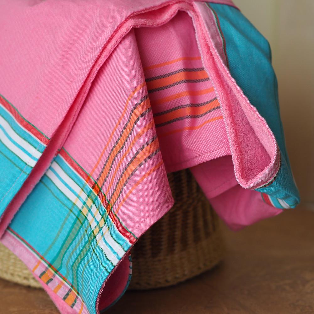 Pink Kenyan Kikoy baby towel.