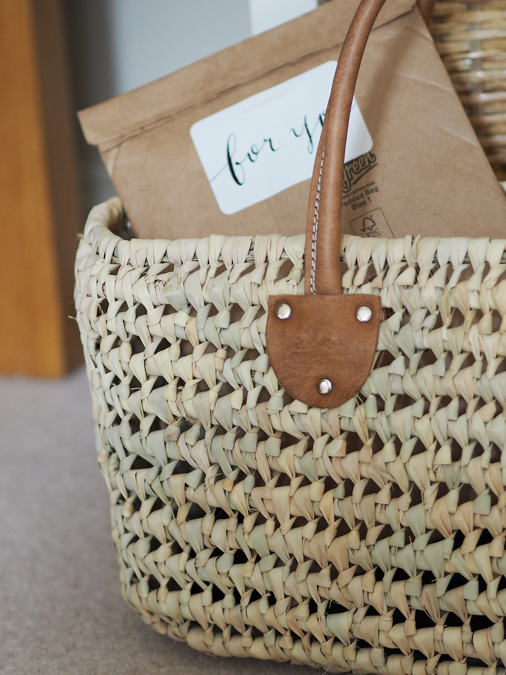 handmade grass basket with post in