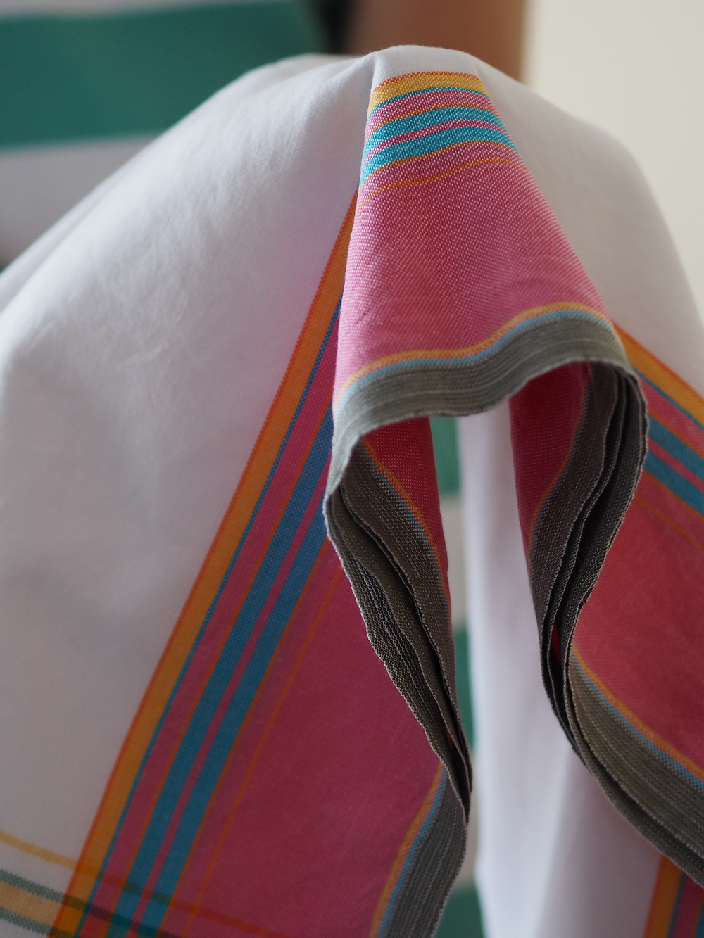 coconut and pink handmade cotton kikoy sarong. Available to buy at Wild Home Online on Etsy.