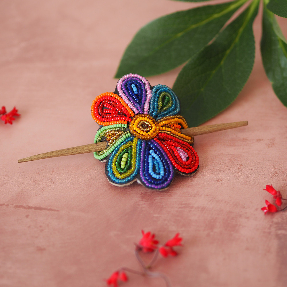 Handmade Kenyan hair barrette with rainbow beads. Available to buy at Wild Home Online on Etsy.