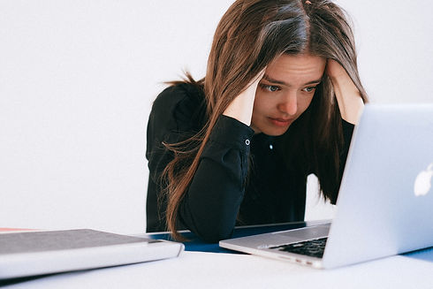 canva-stressed-woman-looking-at-a-laptop