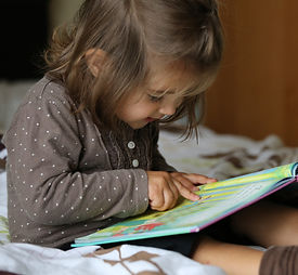 Child reading cartoon book