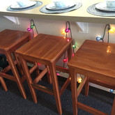 Change up the typical kitchen seating with party lights. Your parent's, or friend's, old themed party lights won't go to waste if you add lighting to an unusally dark place. Photo by Chase Davis.