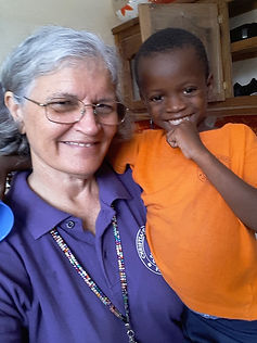 Beverly Burton, missionary to Haiti with Christian Light Ministries, posing with a student