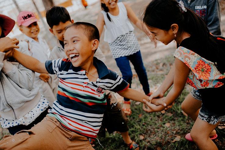 children playing, laughing, smiling