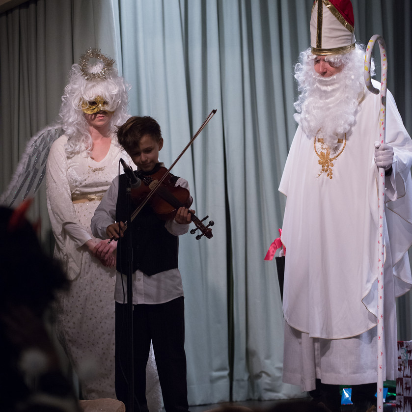 St. Nicholas requires children to perfomr for him!