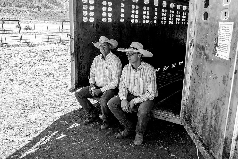 TWO OREGON COWBOYS RESTING in back of horse trailer
