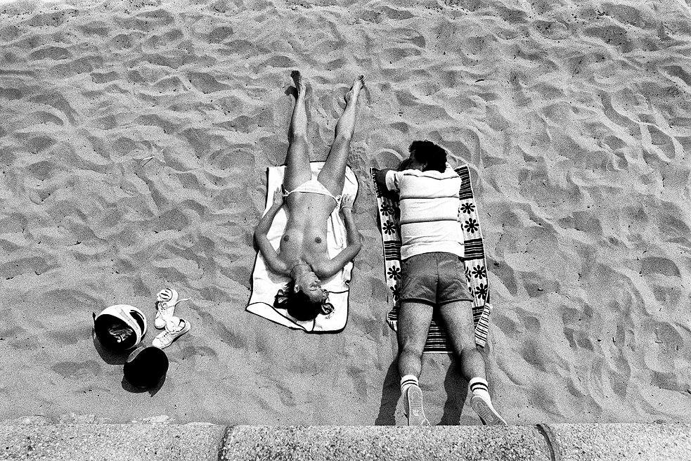 topless sunbather on beach with male friend Cannes France