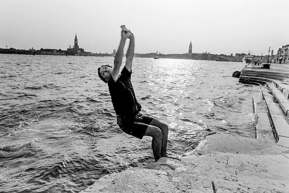 Boy diving into grand canal, Venice