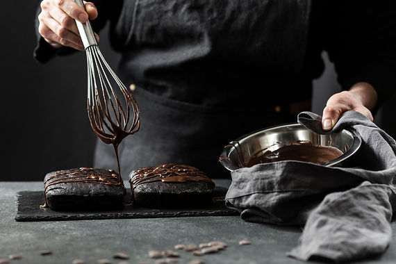 front-view-pastry-chef-preparing-cake-wi