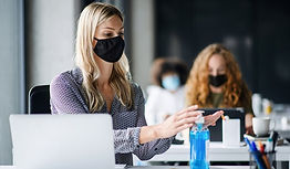 Keeping the Workplace Safe- Employees Wearing Masks